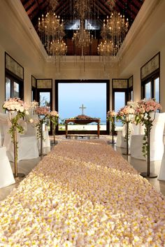 A wedding aisle made of frangipani flowers... This is the Cloud 9 Chapel at St Regis Resort Bali <3