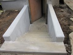 Basement Egress Stairs | The front and backside of the new front porch stairs: