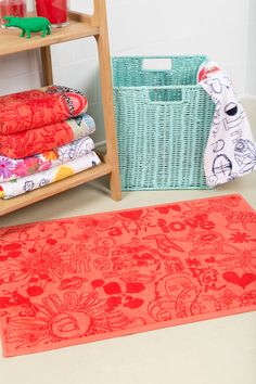 This subtle red printed bathmat can be your very own red carpet!