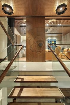 Krishnashray – a+t associates Interior Stairs, Interior Design Living Room, Interior And Exterior, Design Bedroom, Wooden Partitions, Modern Entrance, House Entrance, Bungalow Interiors, Stair Walls