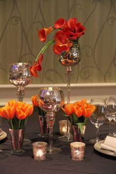 Flame Calla lily & orange tulip wedding reception centerpiece with mercury glass candle holders and votives  Fleurs de France  www.fleursfrance.com