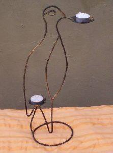 Hierro: Candelabro con forma de ave. por artesaniasenhierro
