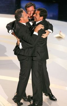 Jon Stewart Steve Carell Photos - TV personalities Jon Stewart, Steve Carell, and Stephen Colbert celebrate onstage during the Annual Primetime Emmy Awards at the Shrine Auditorium on September 2007 in Los Angeles, California. - Annual Emmy Awards - Show The Funny, Funny Men, People Hugging, Men Tv, John Krasinski, Steve Carell, Jon Stewart, Stephen Colbert, Pictures Of People