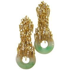 TIFFANY AND CO, Jadeite Earrings, circa 1960. The 14k yellow gold freeform textured wire mounts each supporting a natural color jadeite donut and accented with .50cts of round white diamonds. A very special pair of late sixties- early 70's style earrings.