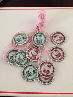 Hello Kitty bottle cap necklaces party favors  on Etsy, $6.99
