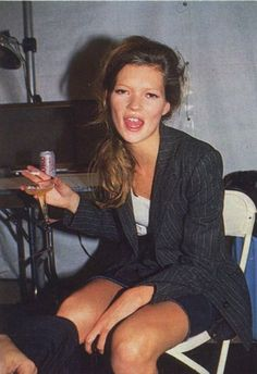 Kate Moss // champagne, cigarette & pinstripe jacket #style #fashion #model