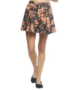 """Ultra feminine skirt  featuring a flared skater construction, floral bouquet printed ponte knit body, elasticized waist band, and a pull on  construction.   Model is 5'9"""" and wears a size small      97% Polyester / 3% Spandex      Hand Wash     USA"""