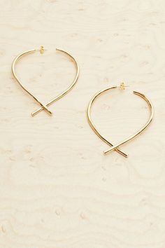 An artful take on the usual pair of oversized hoops.Trademark Wishbone Large Hoops, $118, available at Trademark.  #refinery29 http://www.refinery29.com/delicate-summer-jewelry#slide-18