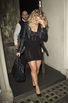 Don't snap me! The usually effervescent Danielle Armstrong covered her face as she left the Libertine Club with her co-stars, rocking a seriously racy partly sheer LBD and heels
