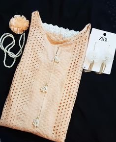 Light peach Chikan Kurta with floral white lace details on daaman and sleeves. Pearl tassels are complementing the decent look… Kurti Sleeves Design, Sleeves Designs For Dresses, Neck Designs For Suits, Neckline Designs, Kurti Neck Designs, Dress Neck Designs, Simple Pakistani Dresses, Pakistani Dress Design, Stylish Dresses For Girls