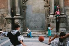 Alex Webb, 'Playing Football (Soccer), Madrid, Spain', 1992
