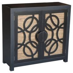 """2-door teak wood media console with geometric-overlaid woven front panels and a black and natural finish. Handmade in Indonesia. Product: Media consoleConstruction Material: Teak wood and fabricColor: Black and naturalFeatures: HandcraftedTwo doorsDimensions: 37"""" H x 36"""" W x 14"""" D"""