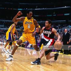 Damon Stoudamire #3 of the Portland Trail Blazers drives to the basket against Kobe Bryant #8 of the Los Angeles Lakers on January 22, 2000 at Staples Center in Los Angeles, CA.