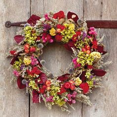 Everlasting Color | Dried floral wreaths are pieces that are not only seasonally appropriate, but also can be enjoyed all year-round. | SouthernLiving.com