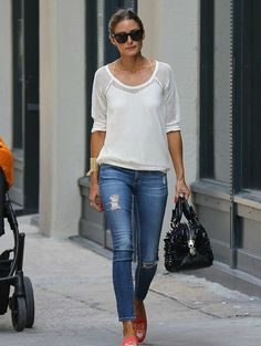 Olivia Palermo in a Tibi shirt, AG Adriano Goldschmied jeans, Stubbs & Wootton shoes, and Westward Leaning sunglasses.