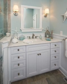 Wall color, wainscoting, shower shelf above sink counter that separates the shower.  Containers are from HomeGoods  Upper Brookville - traditional - bathroom - new york - Robert Kocis