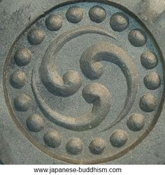 The middle of the dharma wheel represents moral discipline. It often has three swirling elements