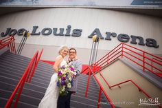 Smiling newlyweds on the steps of Joe Louis Arena #Michiganwedding #Chicagowedding #MikeStaffProductions #wedding #reception #weddingphotography #weddingdj #weddingvideography #wedding #photos #wedding #pictures #ideas #planning #DJ #photography #bride #groom