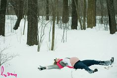 Winter maternity photo shoot: Making snow angels. Might have been better if shot from top?