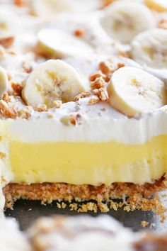 This Banana Cheesecake Dessert has layers of cheesecake, banana cream pudding and cool whip on a graham cracker crust and is topped with banana slices!