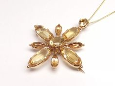 Early Victorian golden topaz brooch also a pendant