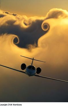 Learjet blasting through the clouds