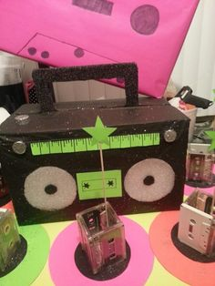 80s boombox cupcake tower and cassette centerpiece