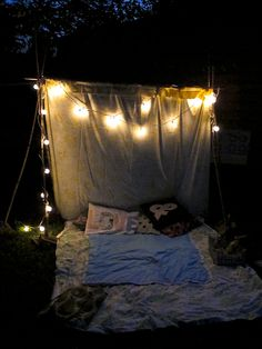 """Backyard tent for date night. Love this idea, especially b/c we have a tradition of regularing """"camping out"""" in the living room. :)"""