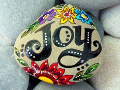 joy. happiness. bliss. painted rock (sea stone) from Cape Cod.  A beautiful stone, worn smooth over time being tumbled in the sea. The colors on