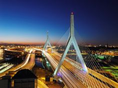The Leonard P. Zakim Bunker Hill Memorial Bridge or Zakim Bridge is a cable-stayed bridge across the Charles River in Boston, Massachusetts. It is a replacement for the Charlestown High Bridge, an older truss bridge constructed in the 1950s. Of ten lanes, the main portion of the Zakim Bridge carries four lanes each way. The bridge's unique styling quickly became an icon for Boston, often featured in the backdrop of news channels, to establish location, and included on tourist souvenirs.