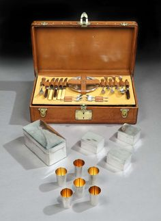 All-Leather Picnic Set by Louis Vuitton, Paris-1925 HEIGHT:	7 in. (18 cm) WIDTH:	22 in. (56 cm) DEPTH:	12 in. (30 cm)