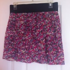 Express mini skirt NWOT Pink and purple floral print on beige with beige liner. Tag says 100% nylon with cotton and modal liner. Bought in 2010 and has never been worn.  Skirt is 15.5 inches long. Very cute just too short for me. Express Skirts Mini