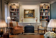 living room idea - built in bookcase, ottoman, console, 2 sitting chairs  John B. Murray Architect: Houses
