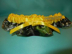 Camouflage garter with the widely popular Mossy Oak TM trim and satin band with ribbons. Available in many colors. Only @ simplycharming.com Prom Garters, Mossy Oak, Ribbons, Camouflage, Satin, Popular, Band, Colors, Bias Tape