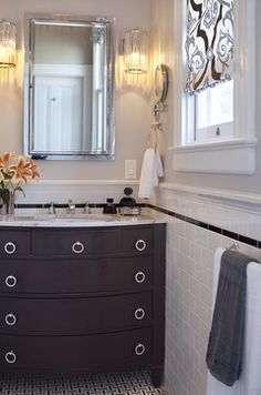 """""""accent lower with one row of subway above"""" """"between tile and wood wainscoting - may come down to cost. Although this vanity isnt our thing, the tile is kind of interesting."""" """"black cabinet and white subway tile and black trim - could be black and white subway tile"""" """"capping a tile wainscot. Sometimes it is called chair rail. Plain white caps top this baths wall tile and a black accent liner plays off the black and white mosaic floor nicely."""""""