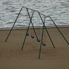 Anchored swing set