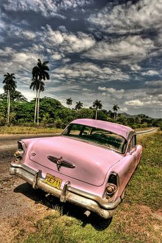 Once Castro took over the control of the island in 1959 it became impossible for most Cubans to obtain permission to buy cars. Therefore, like white Rhinos in fear of extinction, people take great care to preserve the the vintage gems that dot the Cuban highways. Playas del Este, 2006. - Photito - travel photography - http://www.cuba-junky.com