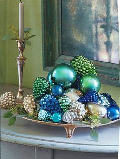 table setting ideas pine cones and candle, using glass pebbles on plastic fruit, etc.