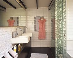 A full width mirror helps make this small bathroom appear bigger.