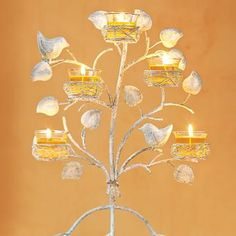 Garden Sanctuary Nest Tabletop & Wall Sconce ~ An enchanting way to bring a touch of springtime nature indoors. Display on table or remove base and mount on wall. Hanging hardware not inc... http://www.partylite.biz/legacy/sites/partywithjessica/productcatalog?page=productdetail&search=true&sku=P91546