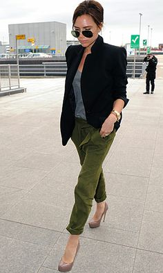 Victoria Beckham is getting playful with her look right now and ditching her standard Audrey Hepburn-esque style in favour of this season's essential utlity trend – a fashion choice we did not predict from the Spice Girl. La Posh teamed her turned up olive-green peg leg trousers with grey T, platform pumps and added a boyfriend blazer with the collar turned up.