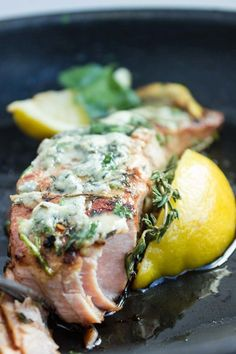 This seared salmon with blue cheese recipe is flavored with brown sugar, garlic and thin lemon slices topped with creamy blue cheese when done.