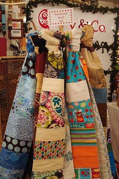 Patchwork Scarves by quayandco, via Flickr -- scarves hanging from cd rack?