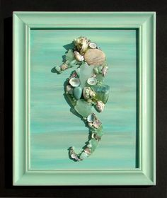 """Seahorse artwork made of sea glass and shells. """"Shell Designs"""" is the team of Mary Bromberger Bowles and Kerrie Ostrowski Bromberger. All seashells, seaglass and sea life used to create our art and crafts are genuine, natural and non-endangered."""