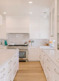 light hardwood floors with white cabinets