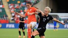 EDMONTON, AB - JUNE 06: Danielle Van De Donk of the Netherlands and Betsy Hassett of New Zealand challenge for the ball during the FIFA Women's World Cup 2015 Group A match between New Zealand and Netherlands at Commonwealth Stadium on June 6, 2015 in Edmonton, Canada. (Photo by Matthew Lewis - FIFA/FIFA via Getty Images)