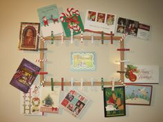 I actually made this! Goodwill frame + painted clothes pins = Showcase your Christmas Cards