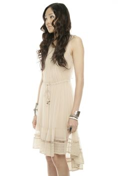This beige High Low Dress is fantastic for a picnic or a party. The dress emphasised the free spirit of anyone who wear it.