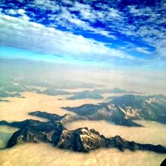 On top of the world... Glimpse of the Rockies 'peaking' through the clouds