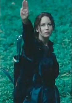 #Katniss (played by #JenniferLawrence) salutes District 11 from inside the arena in #TheHungerGames.